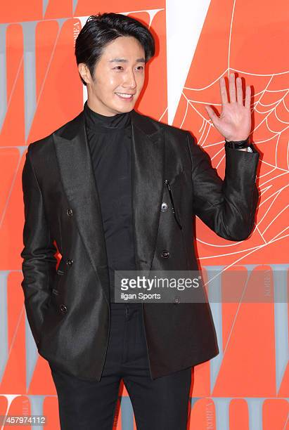 Jung IlWoo poses for photographs during the W Korea campaign Love Your W party at Fradia on October 23 2014 in Seoul South Korea