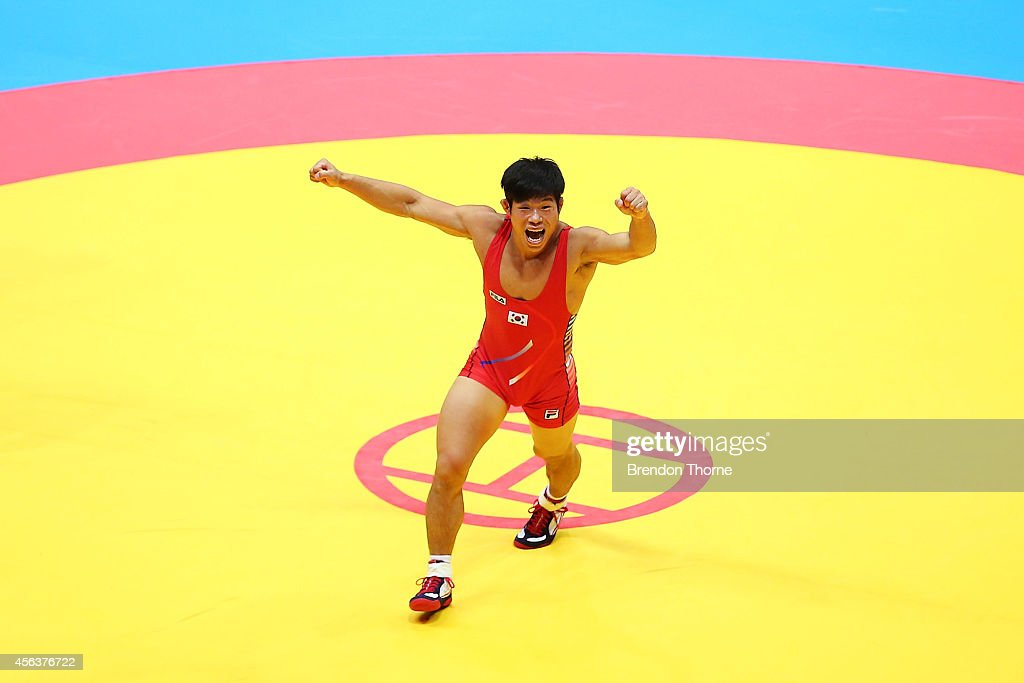 Jung Jihyun of South Korea celebrates claiming the Gold Medal in the Men's Greco-Roman 71kg Gold Medal Match during day eleven of the 2014 Asian Games at Dowon Gymnasium on September 30, 2014 in Incheon, South Korea.