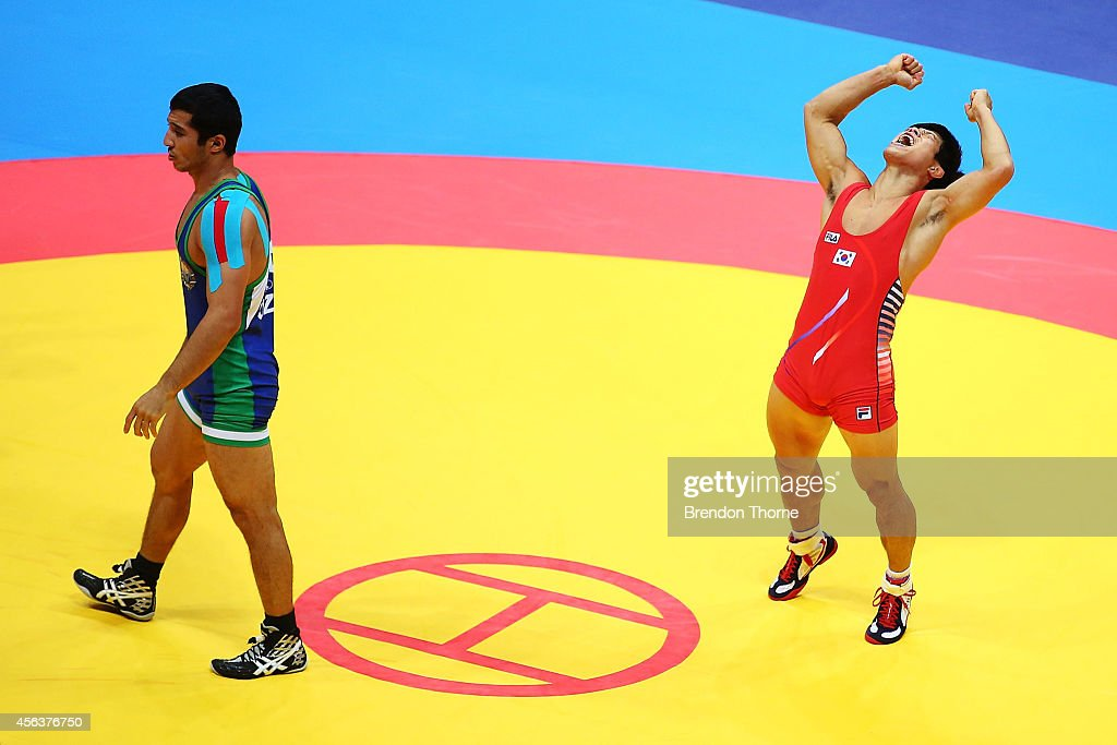 Jung Jihyun of South Korea celebrates claiming the Gold Medal over Dilshodjon Turdiev of Uzbekistan in the Men's Greco-Roman 71kg Gold Medal Match during day eleven of the 2014 Asian Games at Dowon Gymnasium on September 30, 2014 in Incheon, South Korea.