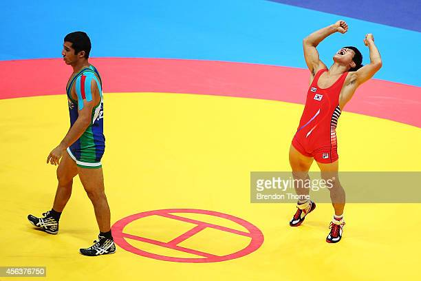 Jung Jihyun of South Korea celebrates claiming the Gold Medal over Dilshodjon Turdiev of Uzbekistan in the Men's GrecoRoman 71kg Gold Medal Match...