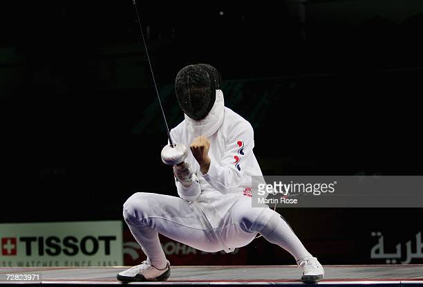 Jung Jin Sun of Republic of Korea celebrates the victory over China in the Men's Team Epee Gold Medal match during the 15th Asian Games Doha 2006 at...