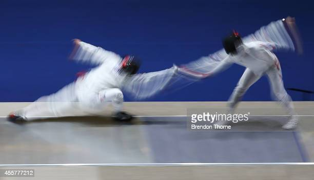 Jung Jinsun and Park Kyoungdoo of South Korea compete in the Men's Epee Final during day one of the 2014 Asian Games at Goyang Gymnasium on September...
