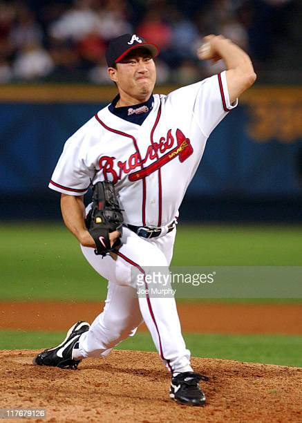 Jung Keun Bong of the Atlanta Braves pitches against the Florida Marlins in the 11th inning at Turner Field in Atlanta, Georgia, September 20, 2003....