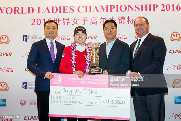 Jung Min Lee of South Korea receives her trophy and check from the hands of TK Pen Wang Liwei and Iain Roberts during the Prize giving ceremony of...