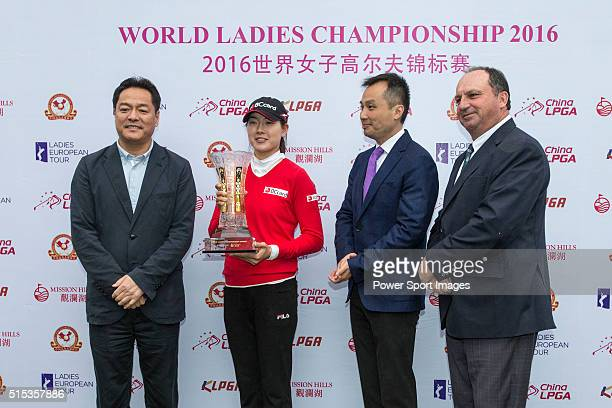 Jung Min Lee of South Korea receives her trophy and check from the hands of Wang Liwei TK Pen and Iain Roberts during the Prize giving ceremony of...