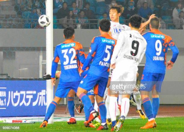 Jung Seung Hyun of Sagan Tosu heads the ball to score his side's second goal during the JLeague J1 match between VVaren Nagasaki and Sagan Tosu at...