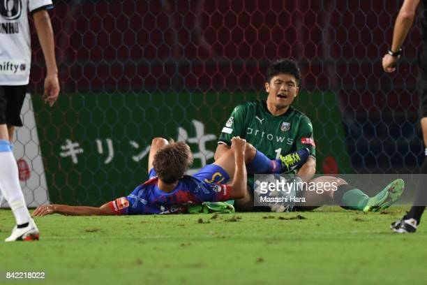 Jung Sung Ryong of Kawasaki Frontale and Kensuke Nagai of FC Tokyo compete for the ball during the JLeague Levain Cup quarter final second leg match...