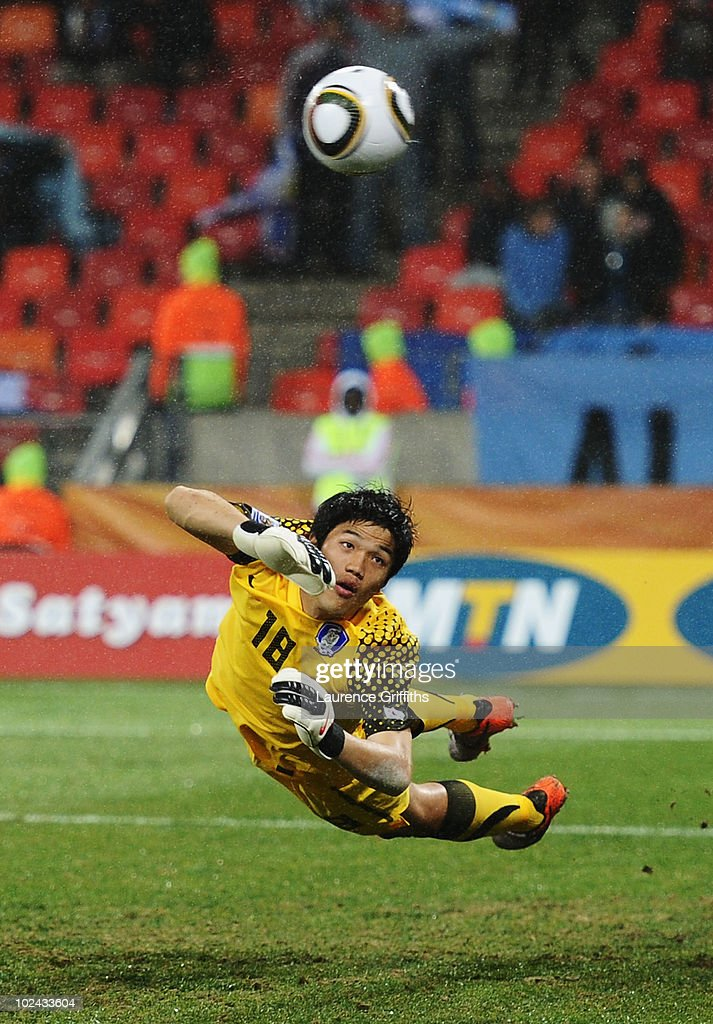 Jung Sung-Ryong of South Korea dives but cannot save Luis Suarez of Uruguay's second goal during the 2010 FIFA World Cup South Africa Round of Sixteen match between Uruguay and South Korea at Nelson Mandela Bay Stadium on June 26, 2010 in Nelson Mandela Bay/Port Elizabeth, South Africa.