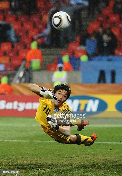 Jung Sung-Ryong of South Korea dives but cannot save Luis Suarez of Uruguay's second goal during the 2010 FIFA World Cup South Africa Round of...
