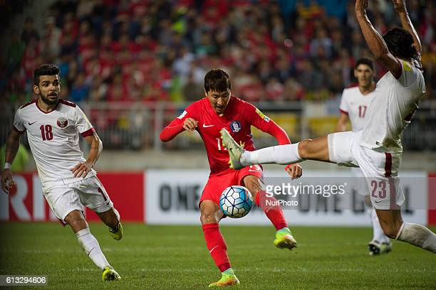 Jung Woo Young of South Korea and Sebastian Soria of Qatar action during an 2018 Russia World Cup Asian Qualifiers South Korea vs Qatar match at...