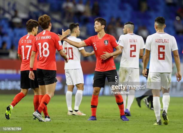 Jung WooYoung and Lee Chung Yong of South Korea shake hands after the AFC Asian Cup Group C match between South Korea and Philippines at Al Maktoum...