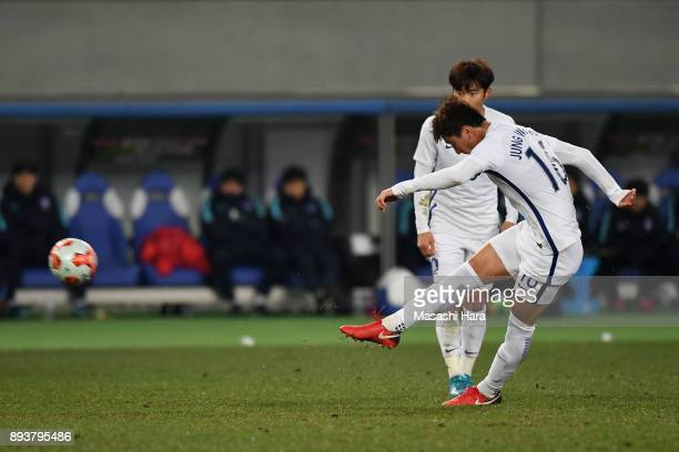 Jung Wooyoung of South Korea scores his side's second goal from a free kick to make it 21 during the EAFF E1 Men's Football Championship between...