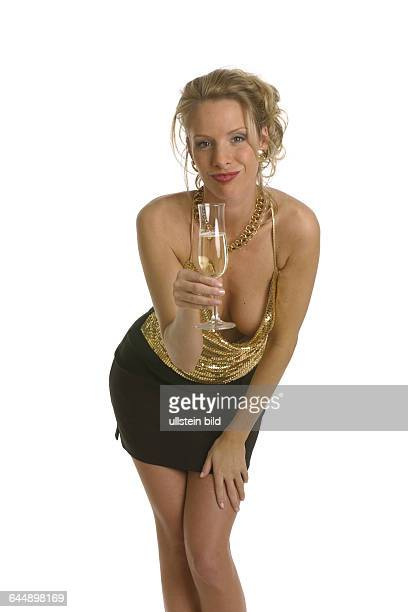 Junge Frau in Party-Kleidung mit Sektglas , young woman clad in a party dress with a champagne glass