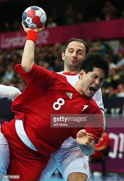 Junggeu Park of Korea shoots while defended by Alem Toskic of Serbia during the Men's Preliminaries Group B match between Korea and Serbia on Day 8...