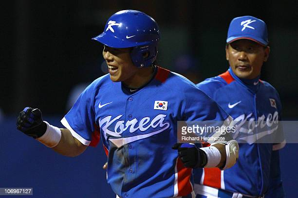 Jungho Kang of South Korea reacts after he hits a third inning home run while taking on Chinese Taipei during the gold medal baseball game at Aoti...