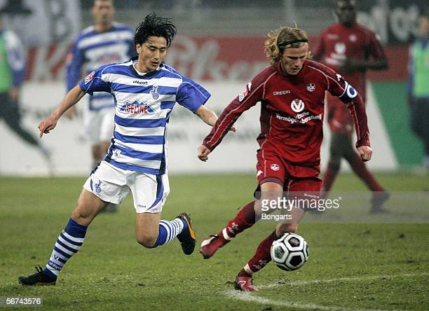 JungHwan Ahn from Duisburg takes on Marco Engelhardt during the Bundesliga match between MSV Duisburg and 1FC Kaiserslautern at the MSV Arena on...