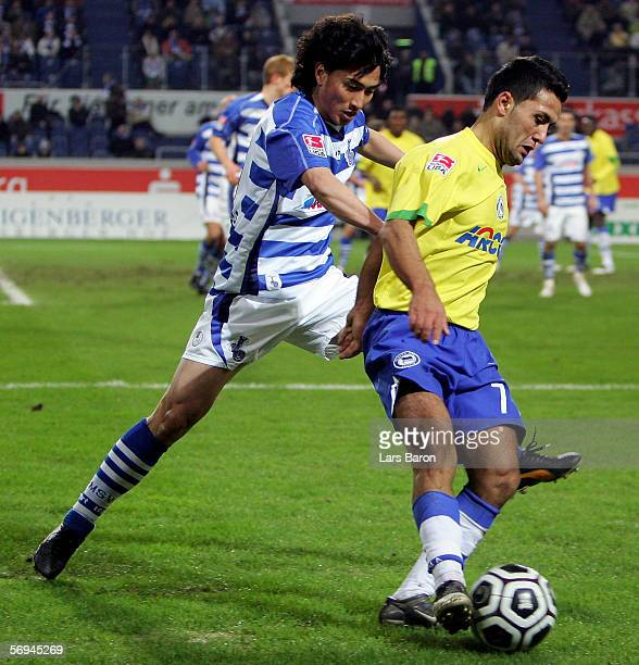 JungHwan Ahn of Duisburg challenges Yildiray Bastuerk of Berlin for the ball during the Bundesliga match between MSV Duisburg and Hertha BSC Berlin...