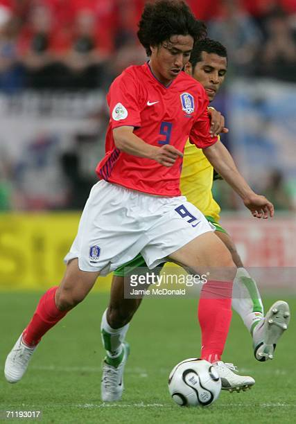 JungHwan Ahn of South Korea and Alaixys Romao of Togo battle for the ball during the FIFA World Cup Germany 2006 Group G match between South Korea...