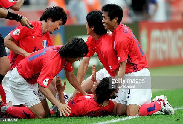 JungHwan Ahn of South Korea is swamped by team mates after he scored the second goal for his team during the FIFA World Cup Germany 2006 Group G...