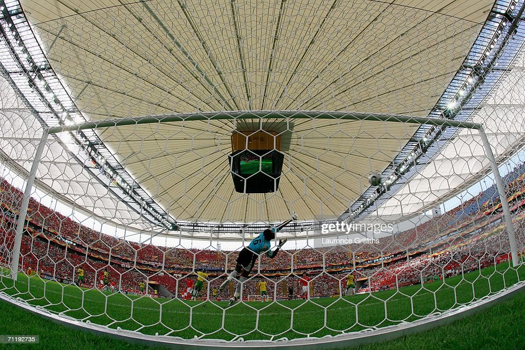 Jung-Hwan Ahn of South Korea shoots and scores the second goal for his team past Kossi Agassa of Togo during the FIFA World Cup Germany 2006 Group G match between South Korea and Togo at the Stadium Frankfurt on June 13, 2006 in Frankfurt, Germany.