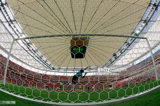 JungHwan Ahn of South Korea shoots and scores the second goal for his team past Kossi Agassa of Togo during the FIFA World Cup Germany 2006 Group G...