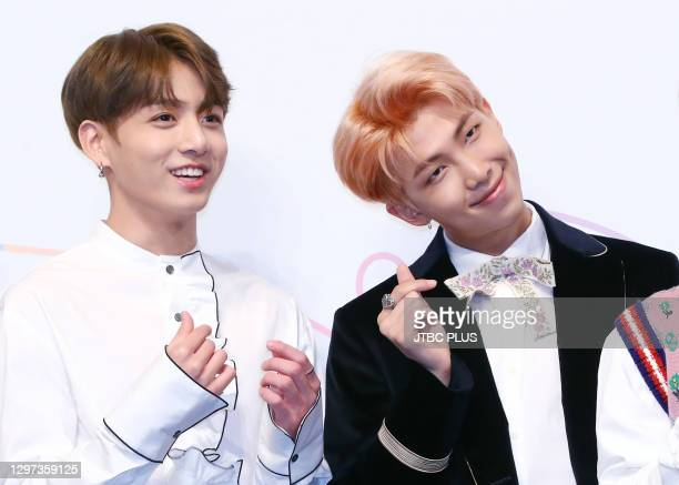 Jungkook and RM of BTS attend the press conference for BTS's New Album 'LOVE YOURSELF: Her' release at Lotte Hotel Seoul on September 18, 2017 in...