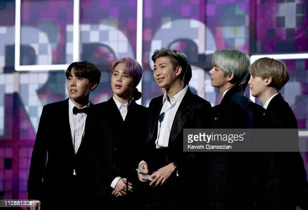 V Jungkook Jimin Suga Jin RM and JHope of BTS speak onstage during the 61st Annual GRAMMY Awards at Staples Center on February 10 2019 in Los Angeles...