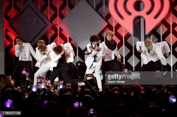 Jungkook, Suga, Jin, V, Jimin, and RM of BTS perform onstage during 102.7 KIIS FM's Jingle Ball 2019 Presented by Capital One at the Forum on...