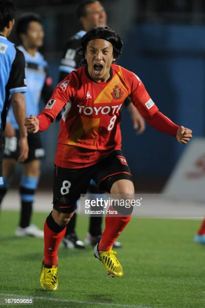 Jungo Fujimoto of Nagoya Grampus celebrates his team's first goal during the JLeague match between Kawasaki Frontale and Nagoya Grampus at Todoroki...
