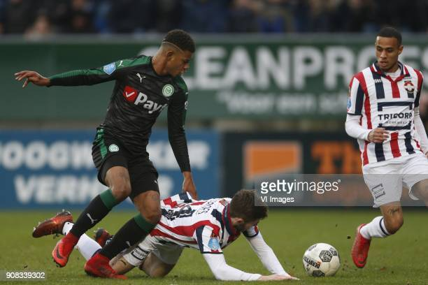 Junhinho Bacuna of FC Groningen Daniel Crowley of Willem II Damil Dankerlui of Willem II during the Dutch Eredivisie match between Willem II Tilburg...