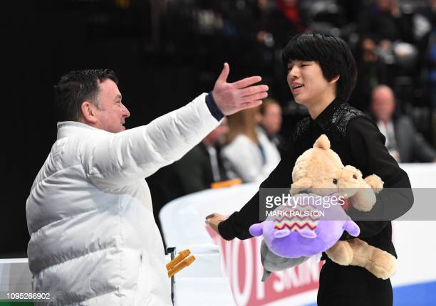 Junhwan Cha of South Korea celebrates after scoring 97.33 during the Men's Short Program of the ISU Four Continents Figure Skating Championship at...