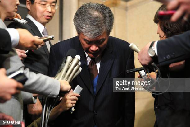 Junichi Fukuda the top bureaucrat at the Finance Ministry bows to media reporters after his resignation on April 18 2018 in Tokyo Japan Finance...