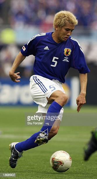 Junichi Inamato of Japan in action during the Japan v Tunisia Group H World Cup Group Stage match played at the OsakaNagai Stadium Osaka Japan on...