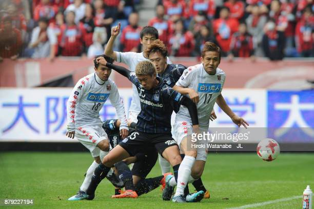 Junichi Inamoto of Consadole Sapporo and Ryo Hatsuse of Gamba Osaka compete for the ball during the JLeague J1 match between Gamba Osaka and...