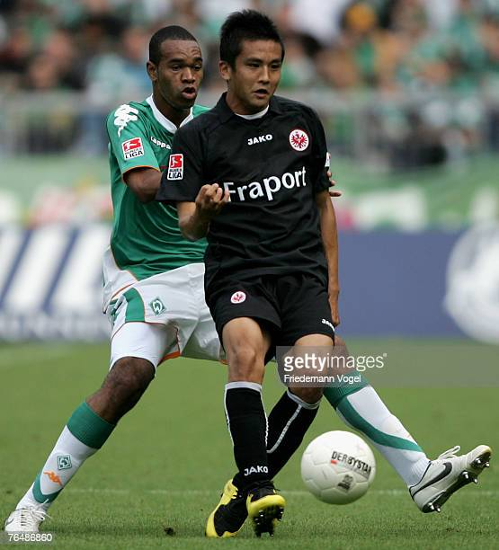 Junichi Inamoto of Frankfurt fights for the ball with Naldo of Bremen during the Bundesliga match between Werder Bremen and Eintracht Frankfurt at...