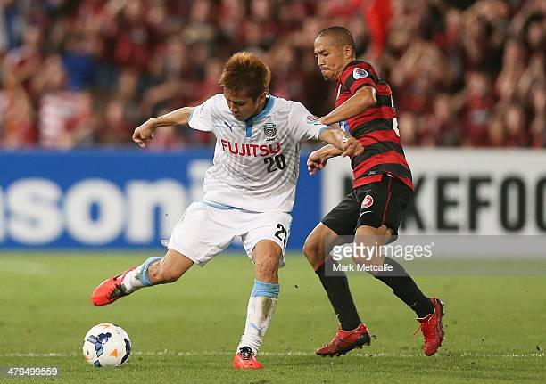 Junichi Inamoto of Frontale takes on Shinji Ono of the Wanderers during the AFC Asian Champions League match between the Western Sydney Wanderers and...