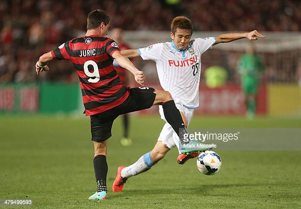 Junichi Inamoto of Frontale takes on Tomi Juric of the Wanderers during the AFC Asian Champions League match between the Western Sydney Wanderers and...