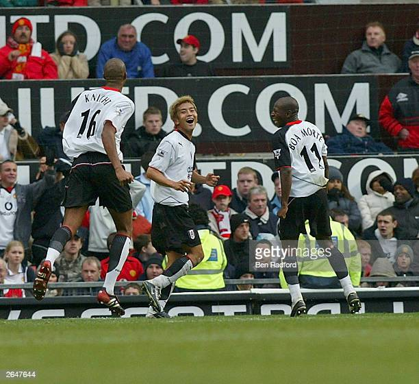 Junichi Inamoto of Fulham celebrates scoring with his team mates during the FA Barclaycard Premiership match between Manchester United and Fulham at...