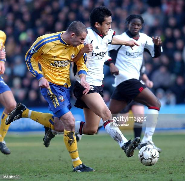 Junichi Inamoto of Fulham takes on Danny Higginbotham of Southampton whilst Louis Saha looks on during the FA Barclaycard Premiership match between...