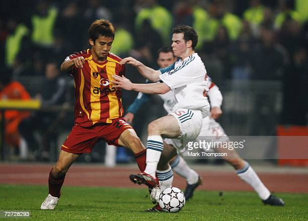 Junichi Inamoto of Galatasaray tangles with Daniel Guthrie of Liverpool during the UEFA Champions League group C match between Galatasaray and...