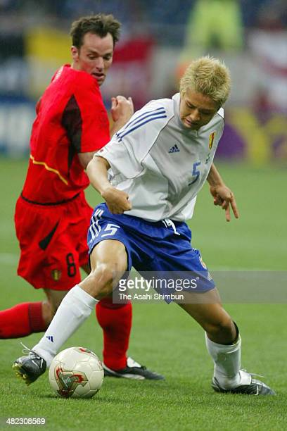 Junichi Inamoto of Japan and Bart Goor of Belgium compete for the ball during the FIFA World Cup Korea/Japan Group H match between Japan and Belgium...