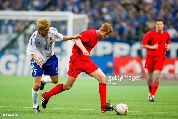 Junichi Inamoto of Japan and Gert Verheyen of Belgium during the World Cup match between Japan and Belgium in Saitama Stadium in Saitama Japan on...