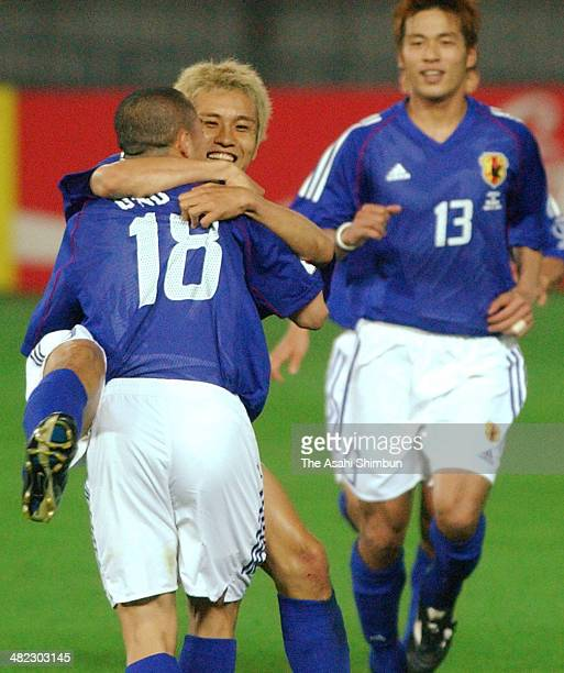 Junichi Inamoto of Japan celebrates scoring his team's first goal with his teammate Shinji Ono during the FIFA World Cup Korea/Japan Group H match...