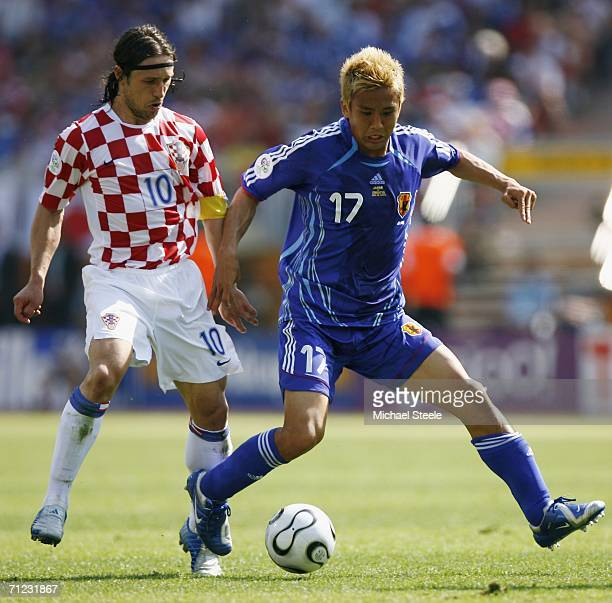 Junichi Inamoto of Japan holds off Niko Kovac of Croatia during the FIFA World Cup Germany 2006 Group F match between Japan and Croatia at the...