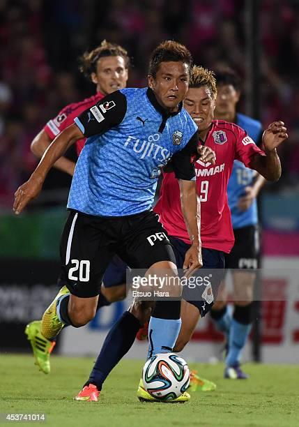 Junichi Inamoto of Kawasaki Frontale and Ryo Nagai of Cerezo Osaka compete for the ball during the JLeague match between Kawasaki Frontale and Cerezo...