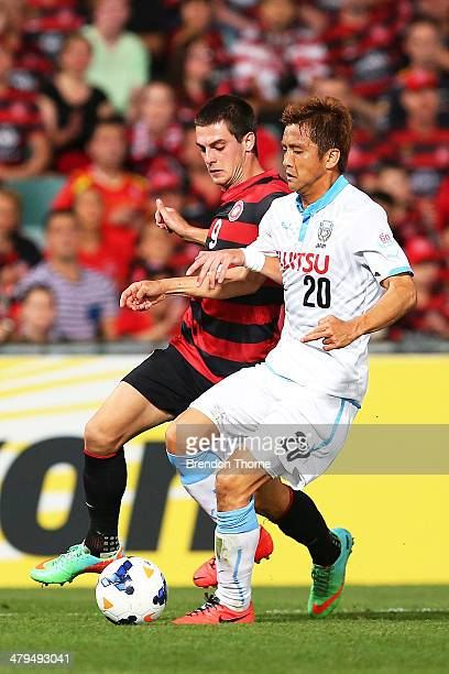 Junichi Inamoto of Kawasaki Frontale competes with Tomi Juric of the Wanderers during the AFC Asian Champions League match between the Western Sydney...