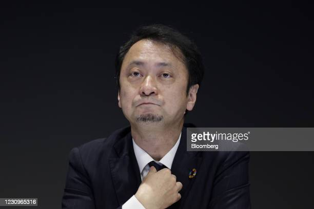 Junichi Miyakawa, incoming president and chief executive officer of SoftBank Corp., adjusts his tie during a news conference in Tokyo, Japan, on...