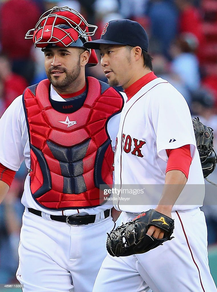 Junichi Tazawa #36 and Sandy Leon #3 of the Boston Red Sox celebrate after the game against the Washington Nationals at Fenway Park on April 13, 2015 in Boston, Massachusetts.