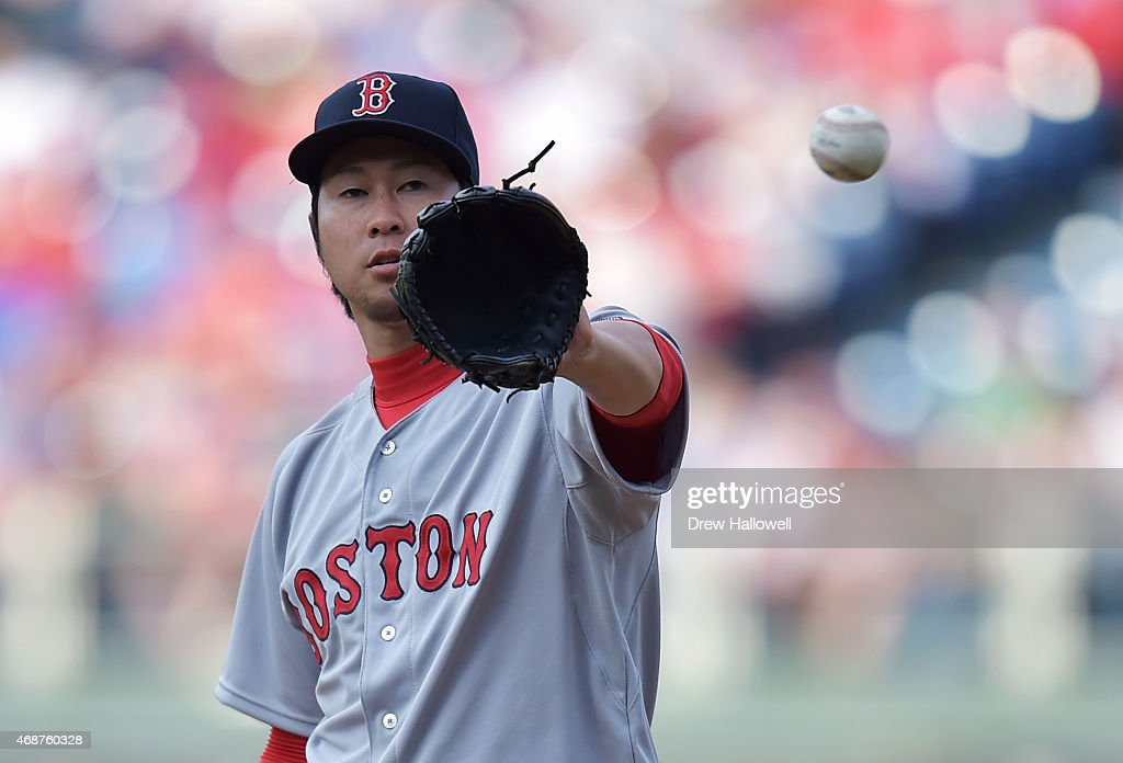 Junichi Tazawa #36 of the Boston Red Sox catches the ball in the eighth inning against the Philadelphia Phillies during Opening Day at Citizens Bank Park on April 6, 2015 in Philadelphia, Pennsylvania. The Red Sox won 8-0.