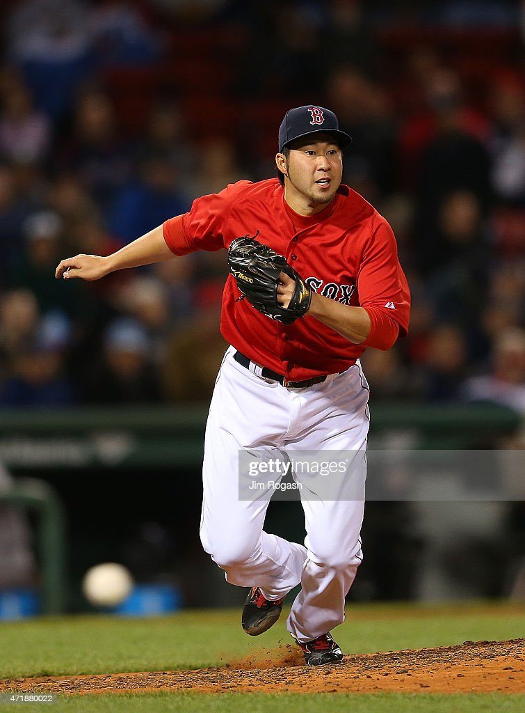 Junichi Tazawa #36 of the Boston Red Sox covers first base on a ground ball against the New York Yankees in the 8th inning at Fenway Park May 1, 2015 in Boston, Massachusetts.